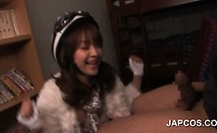 Cute asian girl in cosplay working loaded shaft on knees