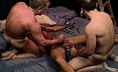 Me and my buddy squeeze a CBT newbie's balls in a vise.