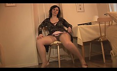 Mature English lady in slip and stockings strips and teases
