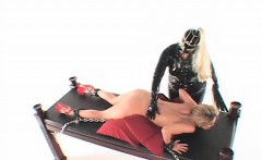 Lesbian BDSM mistress playing with her tied up slaves cunt