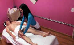 Sensual asian masseuse rubbing client