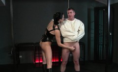 Busty Mistress wanking dick in dungeon boobs jerking