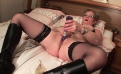 Mature in glasses fucks herself with big dildo