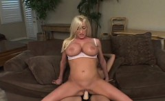 Busty blonde rides a strapon
