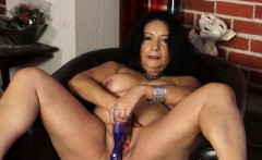 Isis fucks her mature pussy with a sex toy.