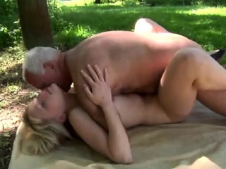 Teens kiss and blow old man John enjoys to lie in the sunshi