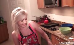 Sexy babe in red apron cooking