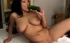 sultry babe with big tits fucks herself with a cucumber in the kitchen