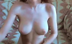 Light redhead girl shows her belongings on livecam