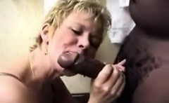Attractive blonde milf licking large cock that is black and
