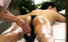 Masseuse oils up her nice ass and back for a sensual massag