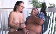 Spex amateur milf giving handjob on the porch