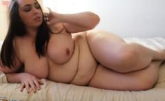 hot brunette plumper putting her naked body on display for