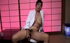 Sexy Asian lady with lovely tits fucks a her pussy with a b