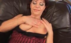 Mature redhead masturbates solo on leather couch