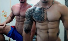 Two Muscle Gays Hooded And Electrified