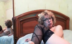 Mature redhead toys her worn pussy