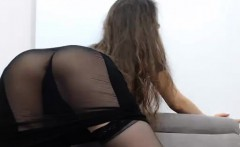 Teasing brunette rubbing her big natural boobs