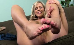 Busty Darcy Tyler Jerks Off Black Dick With Her Feet