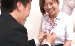 Asian schoolgirl gets undressed to fuck in threesome