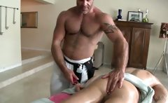 Crazy gay masseur rubbing his clients dick with oil