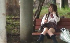 Asian schoolgirl shows panties upskirt in public
