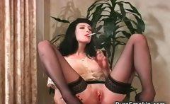 Sexy brunette slut smokes cigarette