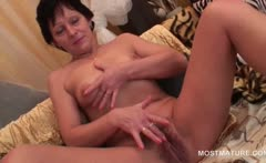 Perky titted mature stunner tasting her own hot pussy