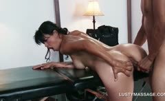 Lusty masseur nailing slick hot pussy over his table