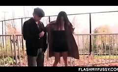 Nympho Asian tramp pissing outdoor and flashing big tits