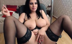 Stacked milf in black lingerie enjoys a cigarette and rubs