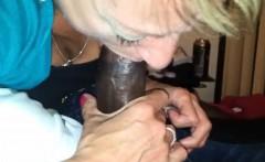 Mature beauty blowing a black shaft