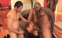 Ebony slut blows on multiple hard rods