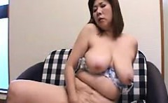 Provocative Japanese lady exposes her big natural tits for