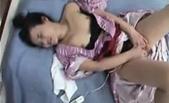 Luscious Oriental wife lies on the bed and takes her snatch