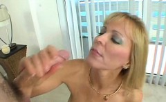 Delightful aged beauty is sucking a huge knob hungrily