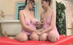 Oriental beauties grease up their bodies and enjoy hot lesb