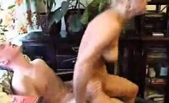 Old mature blonde is giving handjob to lucky dude