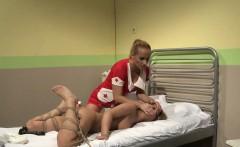 Nurse dominatrix dildo fucking a sub lesbian