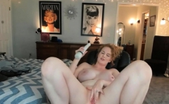 Redhead with big boobs riding cock