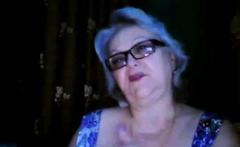 Russian granny ex-teacher flashing her big tits on webcam