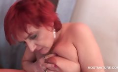 Mature slutty redhead licking tits and rubbing pussy